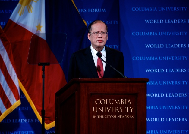 Philippine President Benigno S. Aquino III pauses as a young woman shouts from the audience as he delivers a speech at the World Leaders Forum hosted at Columbia University.