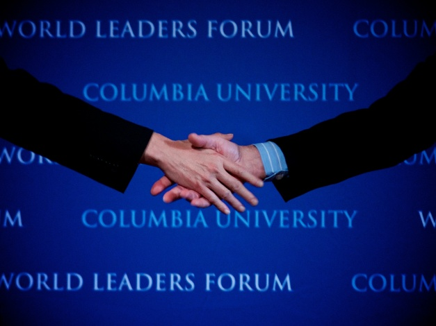 Philippine President Benigno S. Aquino III (Left) shake hands with Columbia University President Lee C. Bollinger (Right) after concluding his speech about Asian peace and progress in Columbia University.